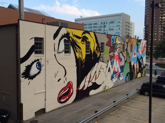 Jordan Weber's mural on the west side of Workspace highlights downtown's transition from old to new.