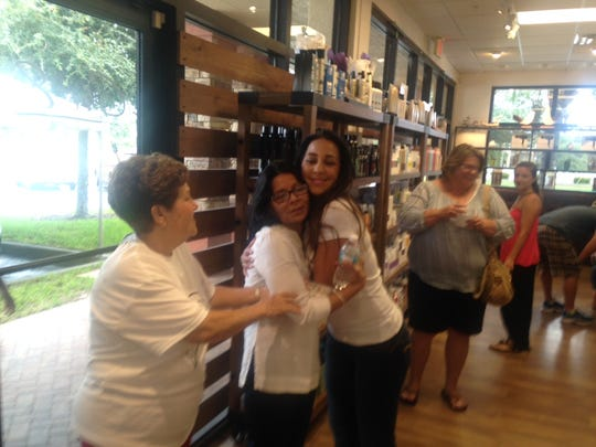 Valerie Velez of North Fort Myers, hugs Nelly Truax,