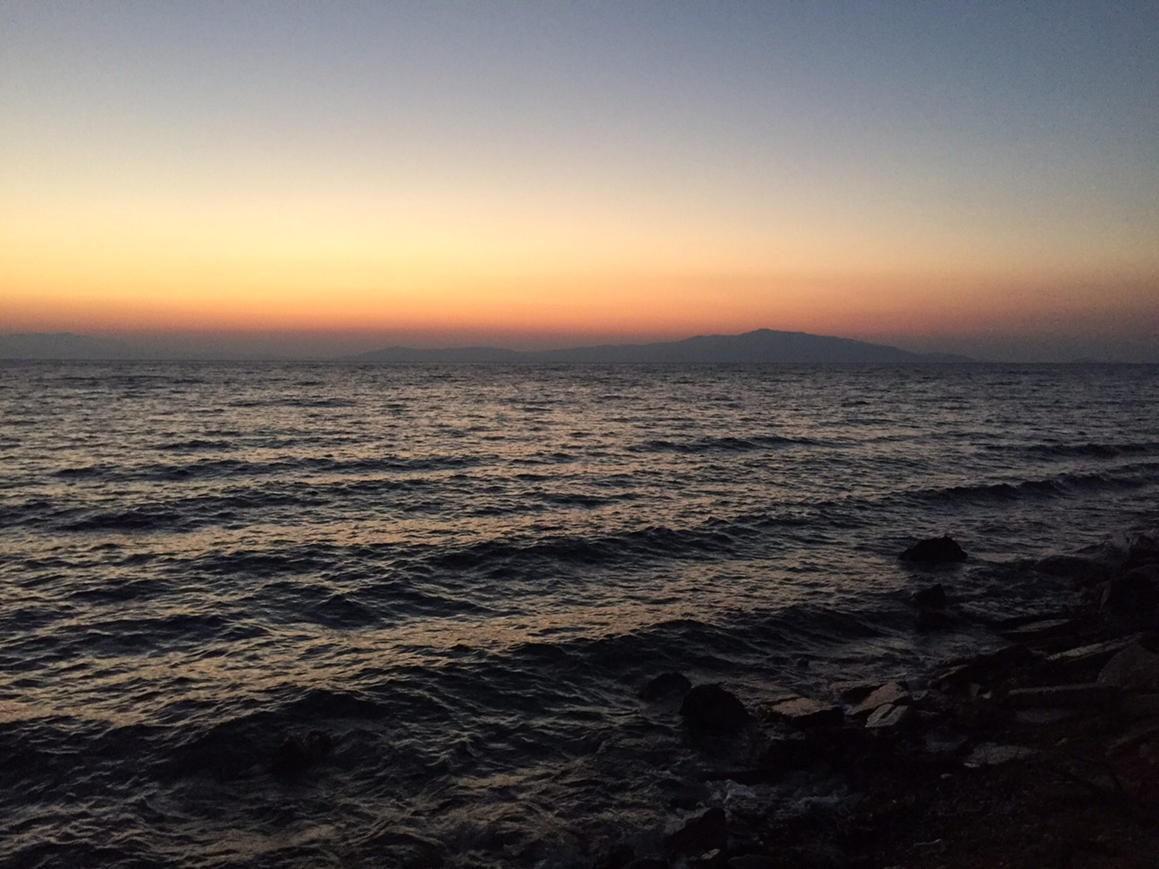 The Turkish mainland is visible from Lesbos, Greece, as the sun rises on Sept. 19, 2015.