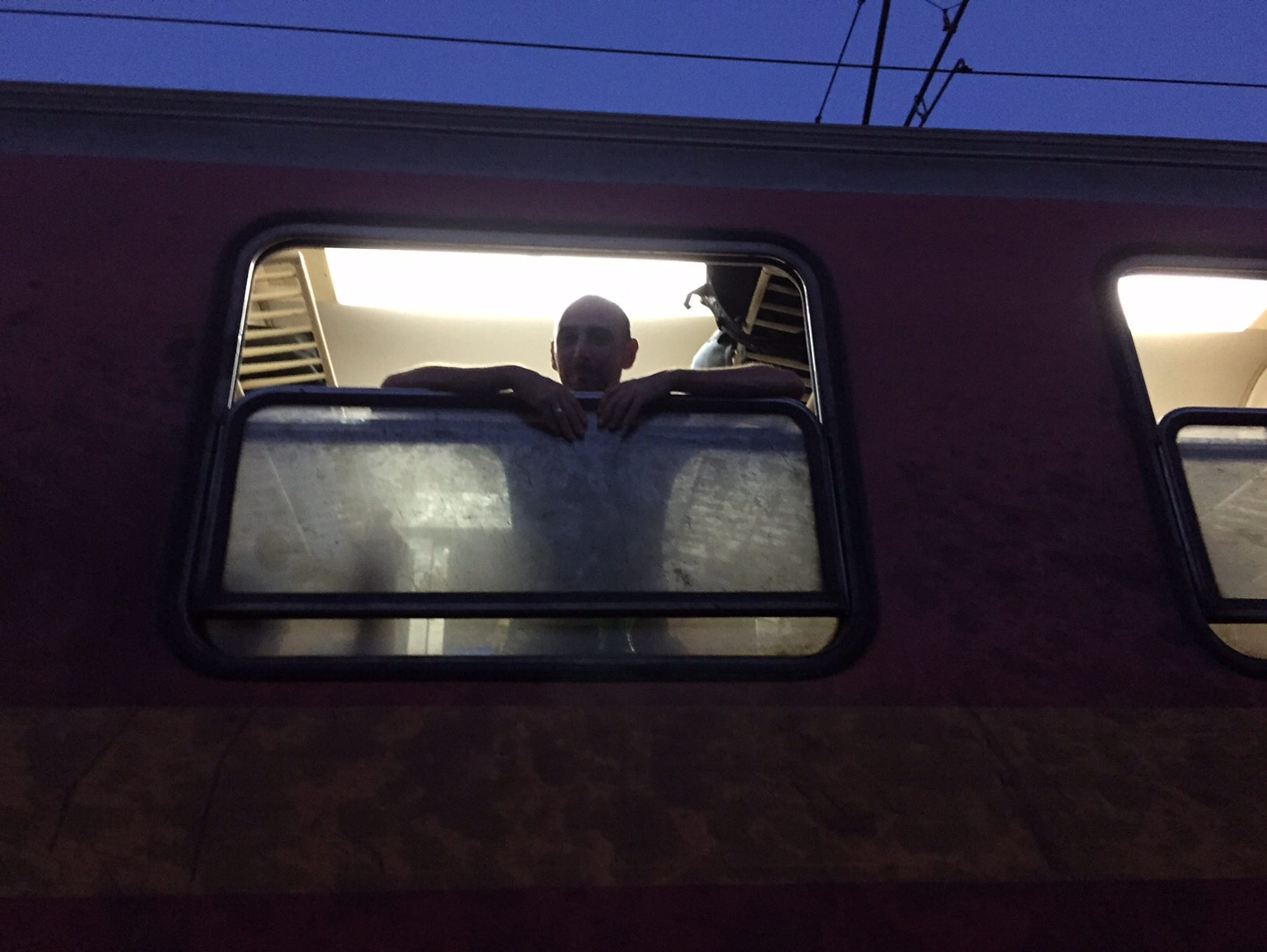 A Syrian refugee waits to depart on a train from Macedonia