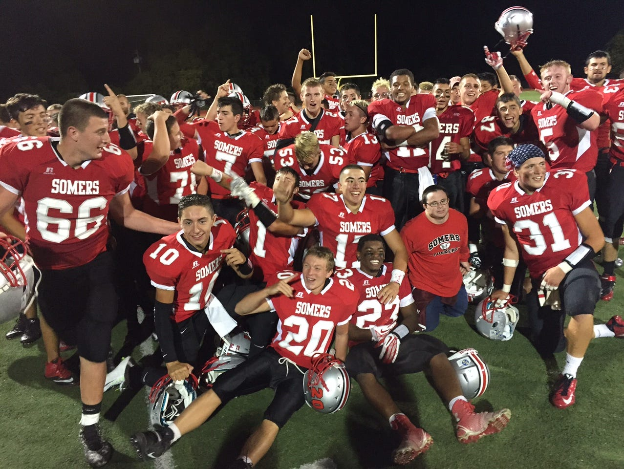 Somers players celebrate their 38-21 win over Yorktown Friday, Sept. 25, 2015.