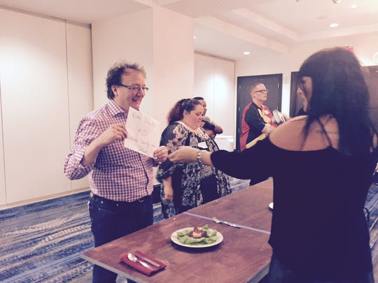Courier-Journal Engagement Director Kim Kolarik prepares for judging of his grilled scallop on beets topped with country ham for MasterChef producer Dani Maule, Saturday, Sept. 26, 2015.