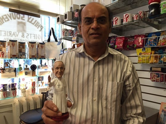 Jay Lodaya opened his store, a dry cleaners which he converted into a gift shop, early on Saturday to maximize his sales.