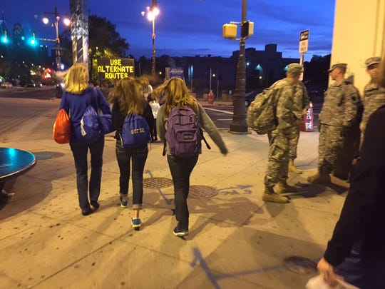 Joan Fassano of Pike Creek walks with her daughter Bridget Fassano and Amanda Clarke on their way to the Benjamin Franklin Parkway.