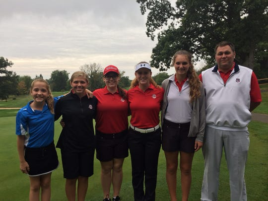 Member of Shelby's district-qualifying golf team: (left to right) 6th grader Nicole Jones, team mascot; Lexy Uplinger, Emma Roberts, Alexis Jones, Clair Korbas and coach Brad Ruminski..