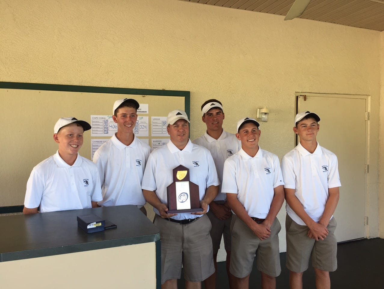 The Ida Baker golf team poses for a picture after its District 2A-20 victory on Monday in Cape Coral.