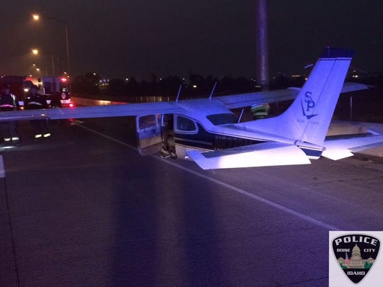 small plane makes an emergency landing on I-84 in Boise, Idaho Tuesday, Oct. 13, 2015.