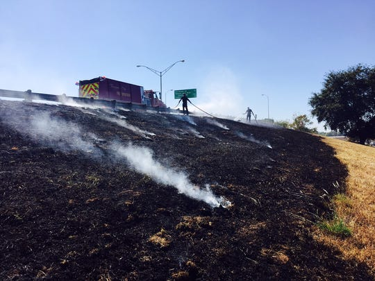 Bossier City firefighters extinguish fires along 1-20 near Airline Drive.