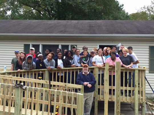 Volunteers from Pocomoke High School helped build a