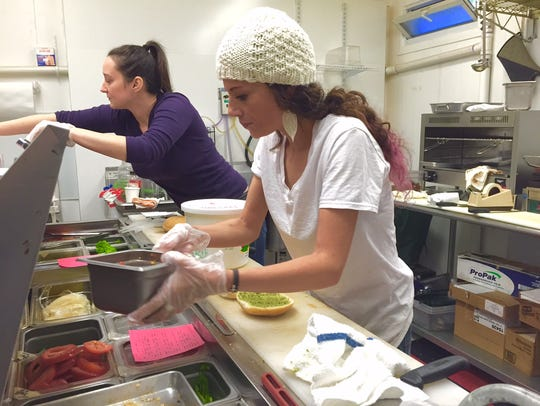 Kathleen Donohue and Amelia Dimmer prepare sandwiches