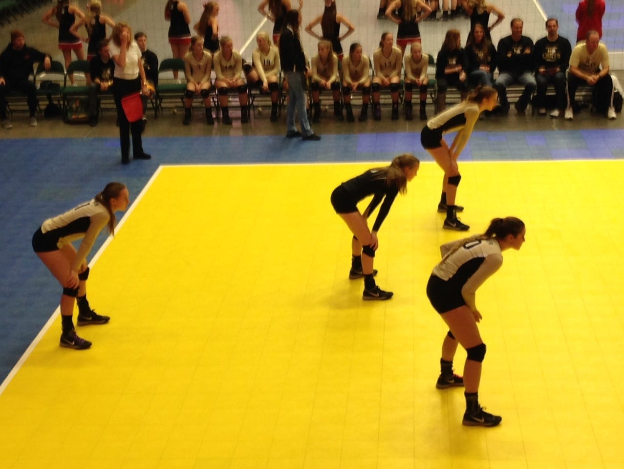 Desert Hills volleyball players get into position during the first set against Richfield on Wednesday in Orem.
