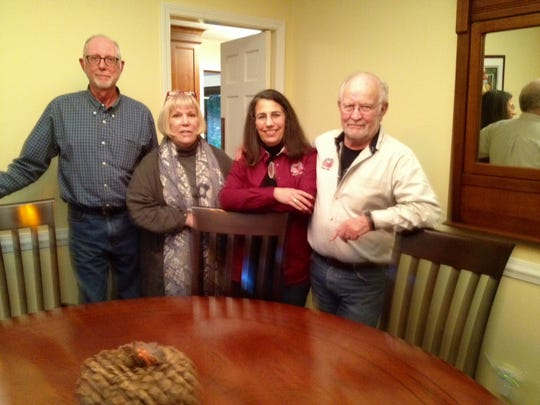 Members of the Louisville  Civil War Round Table gather around a round table at the Thornhill home of Michaeleen Peck, second from left.  The others are John Davis, left, past president; Holly Jenkins-Evans, current president; and Monty Evans, board member.