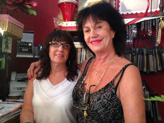 A day after the Paris terrorist attacks, Patricia Troise, left, and Lydie Ollivier of Something Different boutique in Cocoa Village said people shouldn't live in fear. Ollivier spent 40 years in Paris and said she'll still visit her home country.