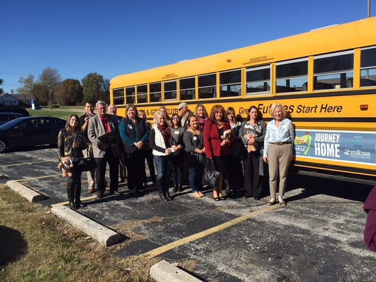 Politicians and community leaders participated in a foster care simulation Friday.