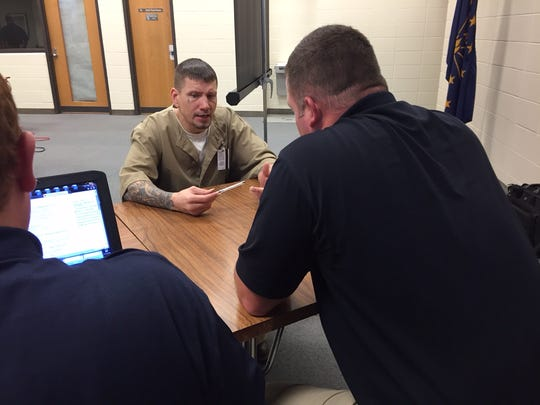 Jeffury Golden, 37, meets with IMPD officer Jamin Davis inside Putnamville Correctional Facility on Dec. 11, 2015. Golden is due to be released before Christmas. Davis met with him to help assess what needs he might have upon his release.