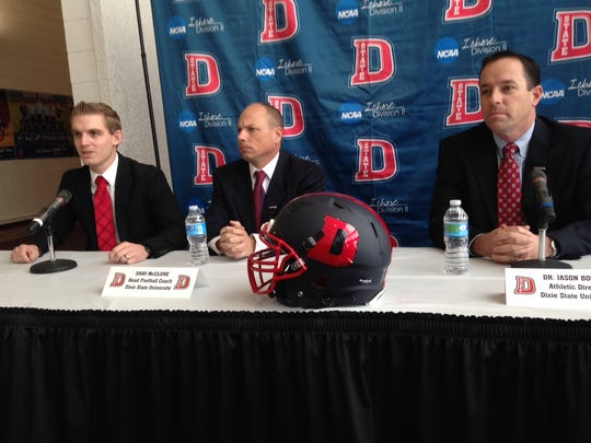 Dixie State University's athletic department named Shay McClure (middle) as head coach of the football program, promoting him from defensive coordinator.