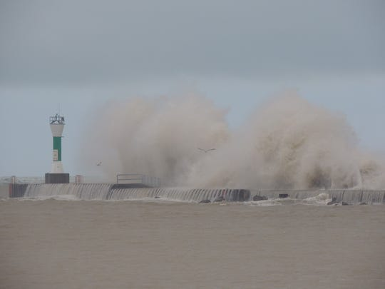 November's windy reputation was well evident as several storms created massive waves on the lakeshore, here at the south pier lighthouse in Manitowoc.