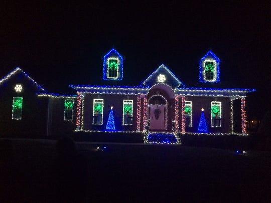 Matt Kruckenberg lights up his home in Rockvale Meadows in Rockvale.