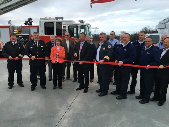 Officials prepare to cut the ceremonial ribbon Wednesday