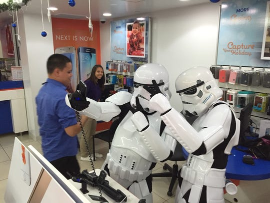 """Storm Troopers try out their selfie skills at GTA during the opening night of """"Star Wars: Episode VII — The Force Awakens"""" at the Agana Shopping Center Dec. 17."""