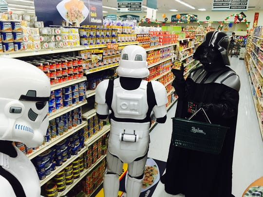 Darth Vader and his Storm Troopers shop for Spam at Pay-Less in the Agana Shopping Center.