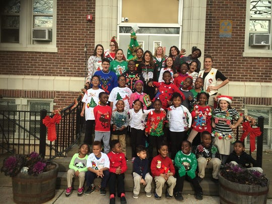 The students and staff at Linden School No. 5 gathered for this holiday photo for the community.