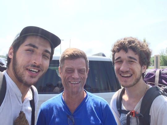 """Steve Doherty, a member of the Appalachian Trail Angels, takes a selfie with two hikers in 2014. """"The AT hikers just graduated from NYU Tisch School and were hiking in a southbound direction,"""" says Doherty. """"I invited them to stay at my house, wash their clothes, take showers and have a couple of meals in exchange for setting up a new smart TV that was confounding me. They had it set up in ten minutes."""""""