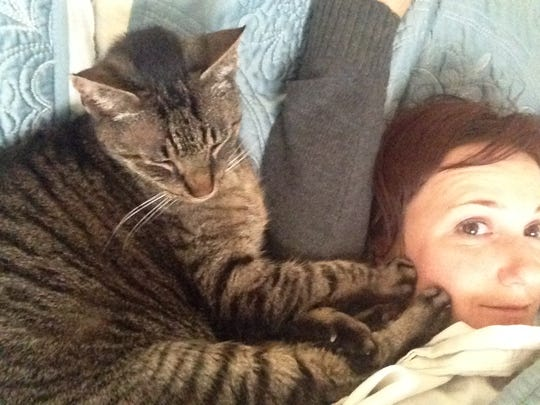 Amber Solnick with her cat, Bruce, who didn't respect boundaries. Bruce recently died, and coping with the loss of a pet can be as hard as losing a human family member.