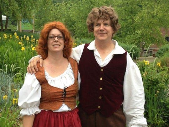 Kimberly and Joe Minter dress in Hobbit-themed attire in preparation for an event at Discovery Center.