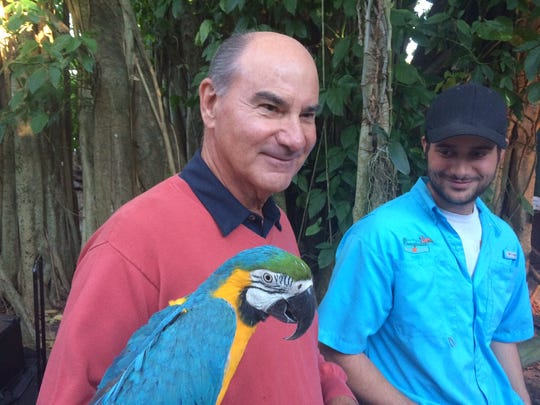 Ernie Schaub, who with his wife Sandie donated $50,000 to the Everglades Wonder Gardens in Bonita Springs, with employee Zack Murphy and one of the attractions.