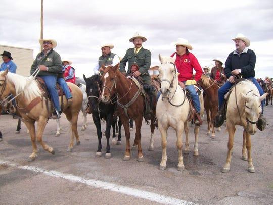 Members of Cabalgata Binacional Villista ride through