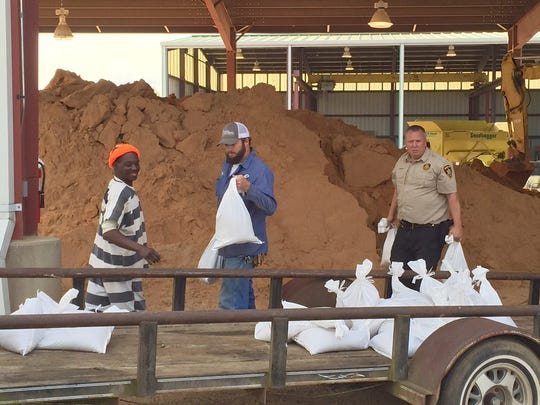 Sandbags are being loaded on a Bossier Parish resident's trailer as forecasters call for extremely heavy rainfall over the next two to three days.