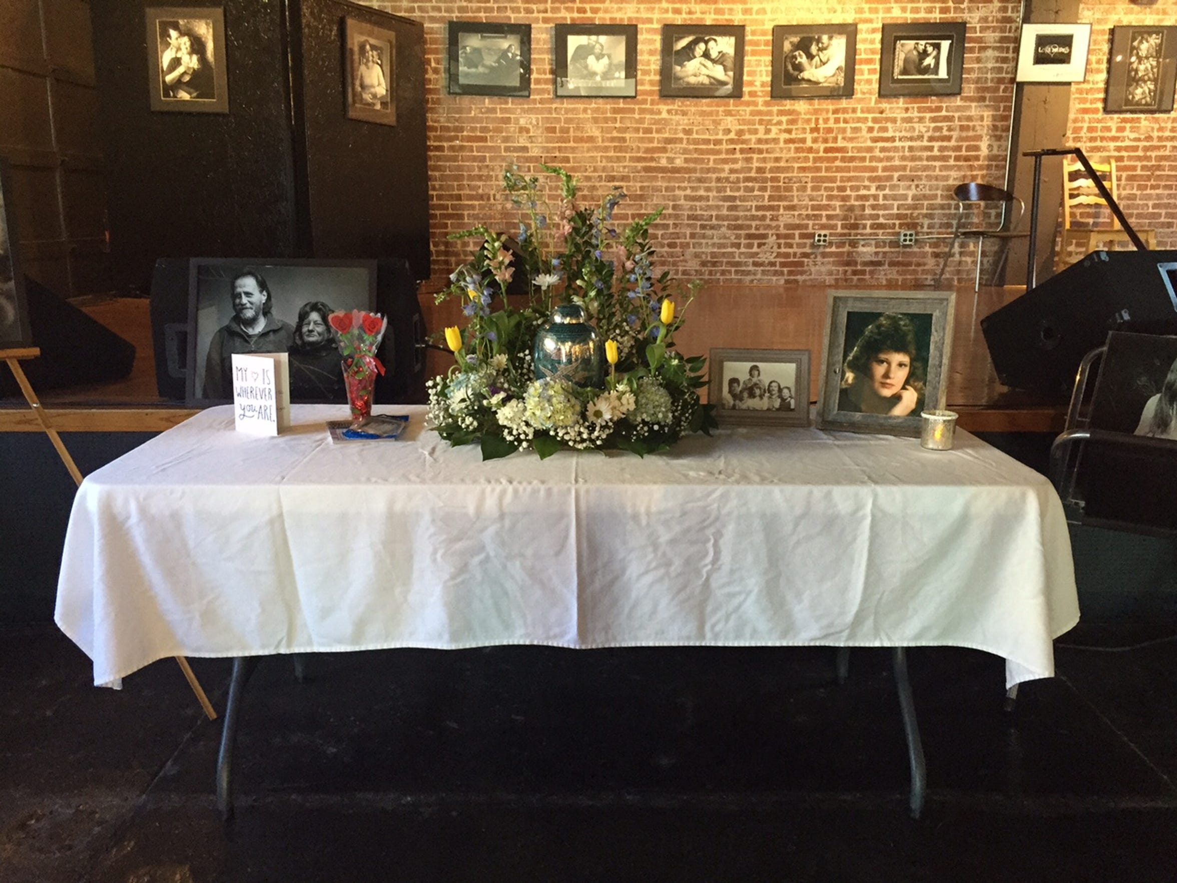 A memorial service for Petra Hensler was held March 5 at Randy Bacon Studio. In the center of the table sits an urn with her ashes.