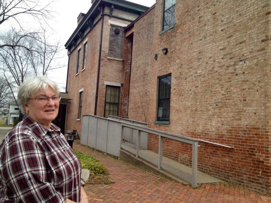 Nathalie Andrews shows off the back part of the Portland Museum, the former Skene Mansion.