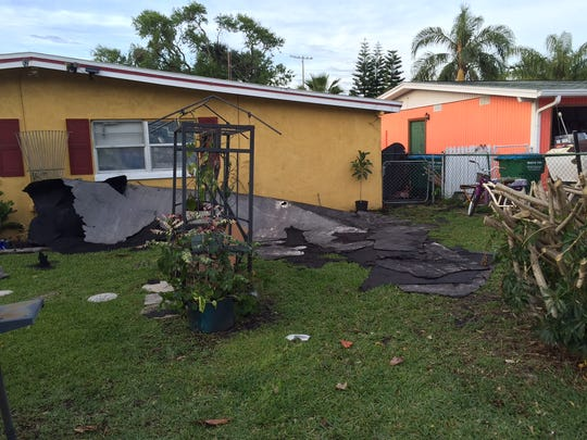 Roof damage in Cape Canaveral from a storm that passed through Brevard on Friday.