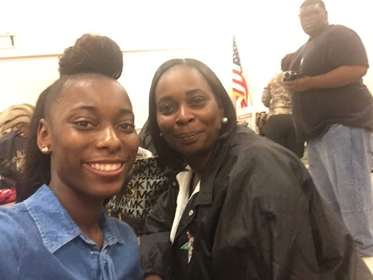 Tehya Kendrick (left). Lehigh class of 2016, waits with her mom Memarie Kendrick on Sunday in Fort Myers to board the bus that will take her to see colleges and civil rights sites across the South.