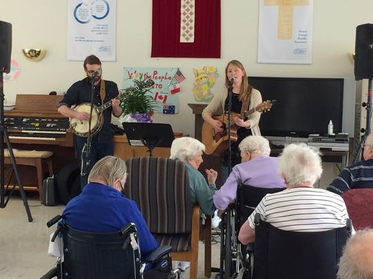 Nick Hoover and Jess Holland sing folk music at the Scandia Village for the Mind Music Program.