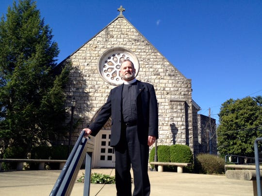 Michael Mernaugh, leader of Anamchara Faith Community, stands in front of Crescent Hill Presbyterian Church, where the group meets on Sunday evenings.
