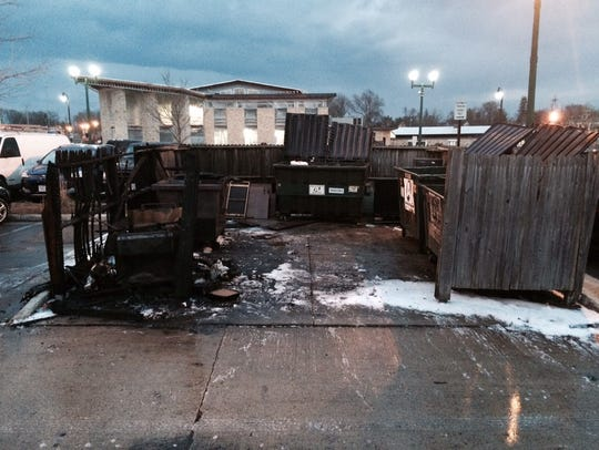 What remains of a dumpster after it caught fire in