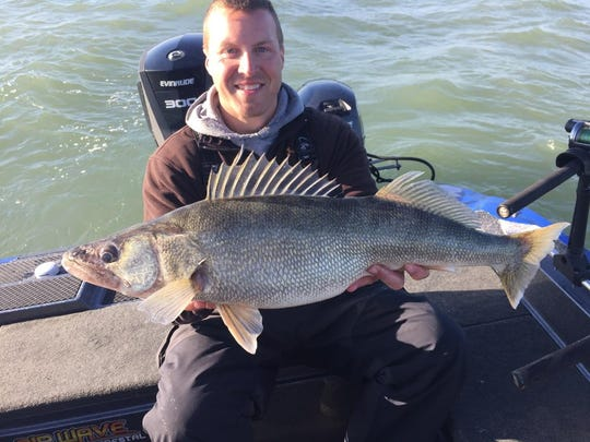 Jason Kron holds a walleye from Lake Erie.