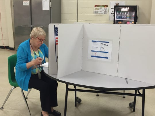 Rosemary Slacum, a volunteer at Mardela Middle and High School, casts her ballot in the 2016 primary election.