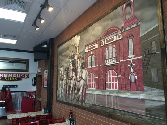Inside Firehouse Subs is a mural of the former Oshkosh