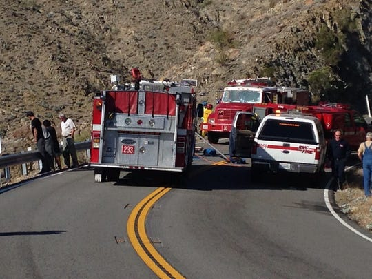 Authorities blocked Highway 74 after a vehicle went over the edge Sunday morning.