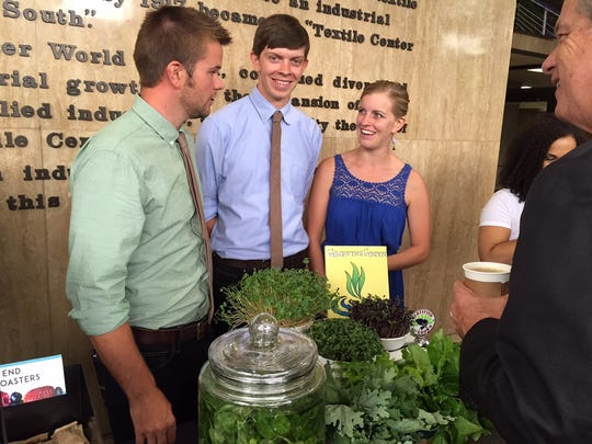 The owners of Growing Green Family Farms, Chris Ostlund, Nathan Vannette and Jenny Ostlund.