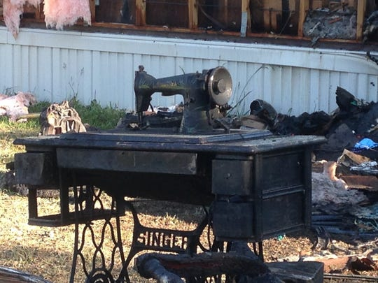 A Singer sewing machine sits among the debris following a Sunday night fire at a Dillsburg trailer.