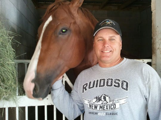 Jess Good Candy with trainer Clint Crawford.