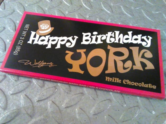 Three thousand of these Wolfgang chocolate bars are now for sale at dozens of participating shops in downtown York.  Hidden in 275 of the bars are golden tickets, good for admission to York's 275th birthday bash this summer.