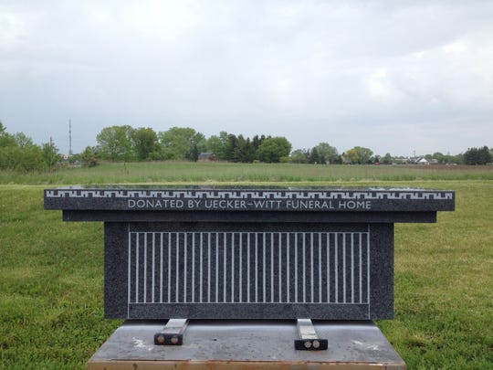 A bench donated by Uecker-Witt Funeral Home is installed at Rienzi Cemetery.