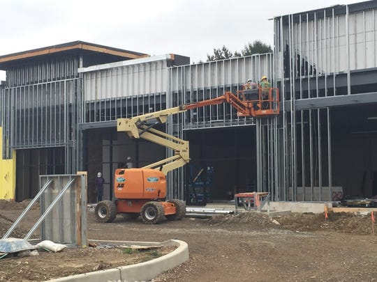 Workers are building a 17,000-square-foot shopping center at the site of the former Haddonfield Road headquarters of the Multiple Sclerosis Association of America.