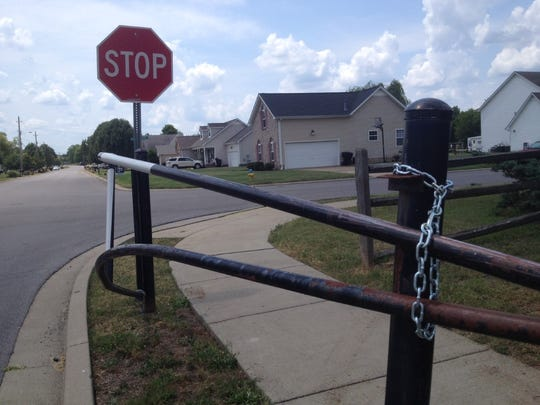 New chains now secure the bent gate that struck a vehicle last week at the Cason Trail Greenway Trailhead.